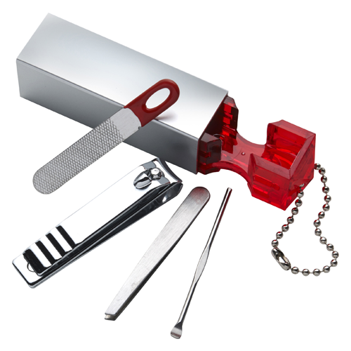 Four piece plastic manicure set. in red