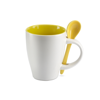 Mug with spoon in yellow
