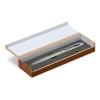 Laser pointer in wooden box in silver