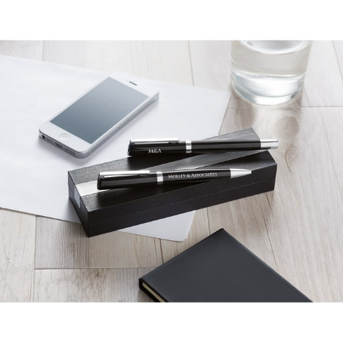 Pen and roller in paper box in black